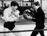 Clark Gable (li.) und Spencer Tracy beim Boxen