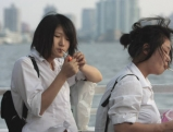 Two femaile students smoke cigarette on a ferry, 2008