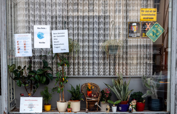 Signs in the window of a closed bar during the 2nd lockdown in Berlin-Neukölln.