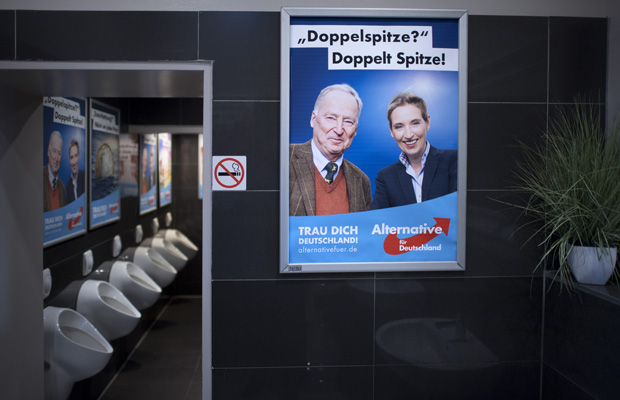 DEU, Deutschland, Germany, Berlin, 24.09.2017 Plakat von Alexander Gauland, Spitzenkandidat der AfD, und Alice Weidel, Spitzenkandidatin der AfD (v.l.n.r.), auf der Toilette auf der Wahlparty der Partei AfD, Alternative fuer Deutschland, am Wahlabend im Traffic Club in Berlin. Wahl fuer die Bundestagswahl zum 19. Deutschen Bundestag am 24. September 2017 in Deutschland. Poster of Alexander Gauland, candidate AfD for the general election, and Alice Weidel, candidate AfD for the general election (f.l.t.r.), on the mens toilet at the celebration on election night of the right-wing party AfD, Alternative fuer Deutschland, Alternative for Germany, at the Traffic Club in Berlin, Germany. Germans federal elections of the German Bundestag on September 24, 2017